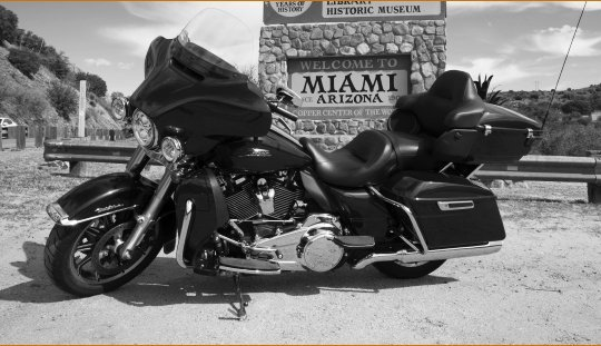 Harley-Davidson Rentals and TowingElectraGlide Ultra in front of Miami Arizona Sign. Rentals, tours, retreats in Sedona Flagstaff Jerome Phoenix AZ